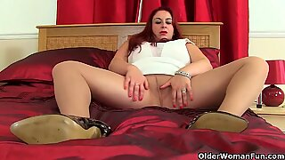 Big titted milf Jane from the UK dildos her fanny
