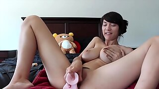 Horny Asian babe has a new plastic friend